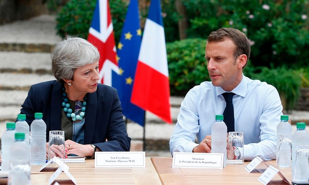 May and Macron hold informal Brexit talks in France