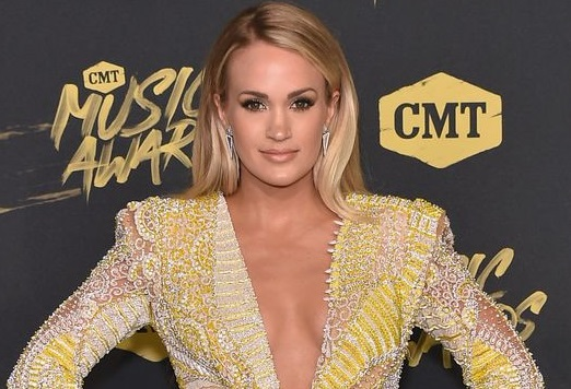 Carrie Underwood is pregnant, tells fans she is over the moon