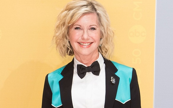 Olivia Newton-John reveals she is using cannabis oil to treat pain as she battles cancer for third time