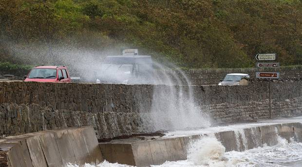 Storm Ali: woman dies in Ireland after caravan blown off cliff