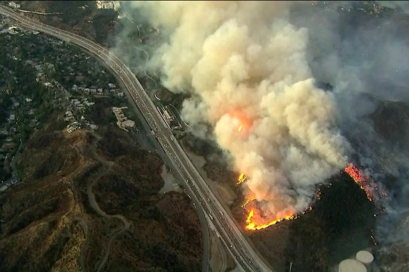 Getty fire off 405 Freeway in L.A. destroys several homes; thousands flee