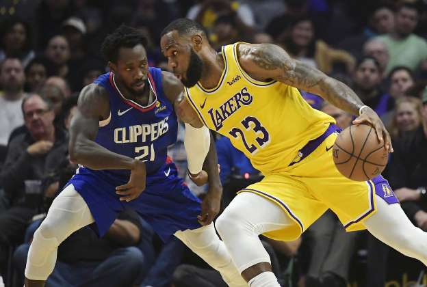 With LeBron back, Lakers outlast Clippers in OT 123-120