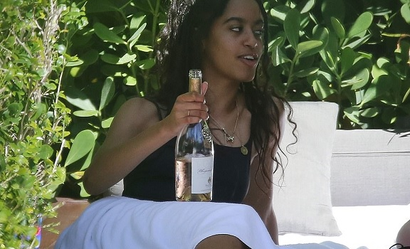 Malia Obama, 20, spotted sipping on a $20 bottle of Whispering Angel Rose with friends in Miami