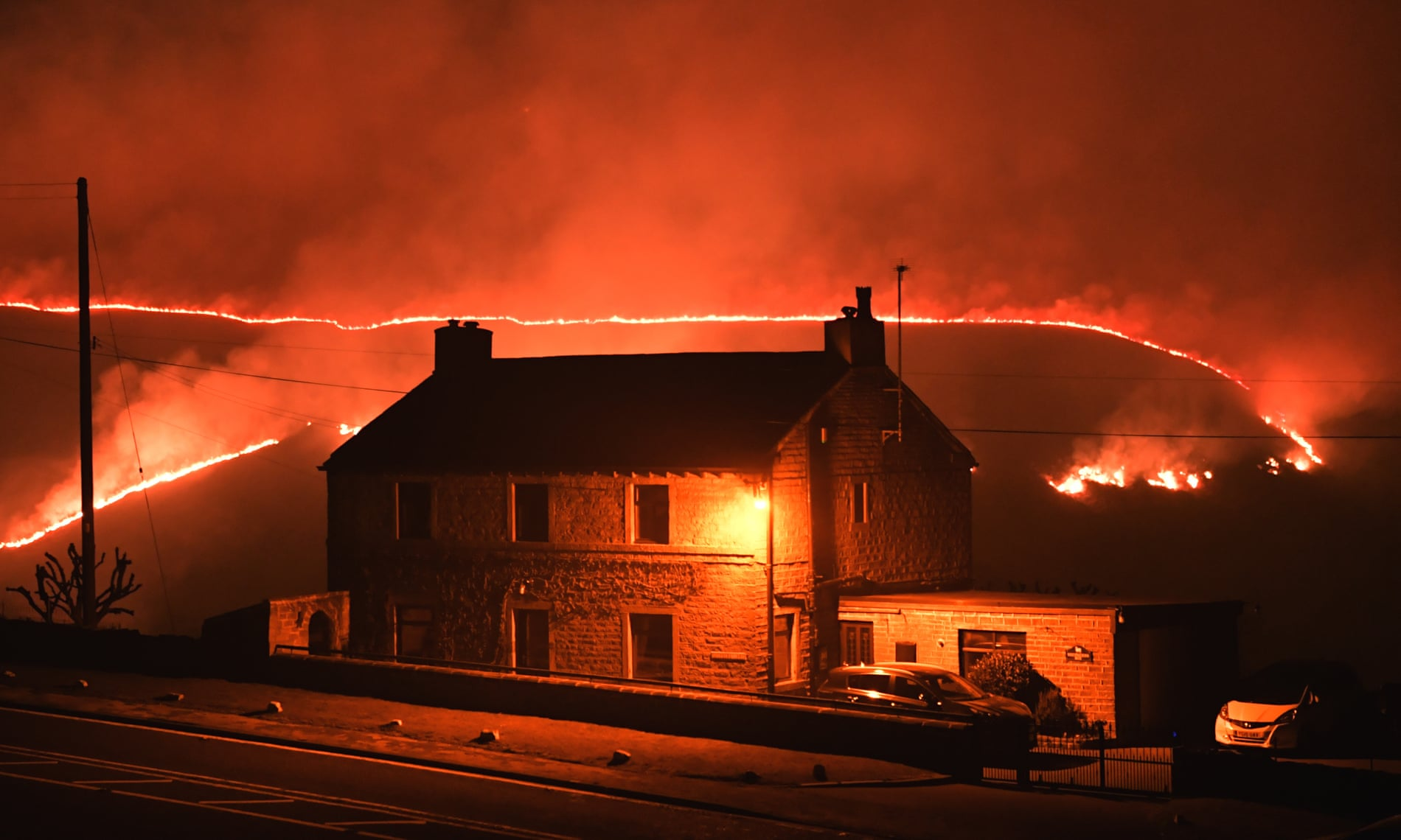 Firefighters Tackle Huge Blaze On Saddleworth Moor Following Hottest Winter Day