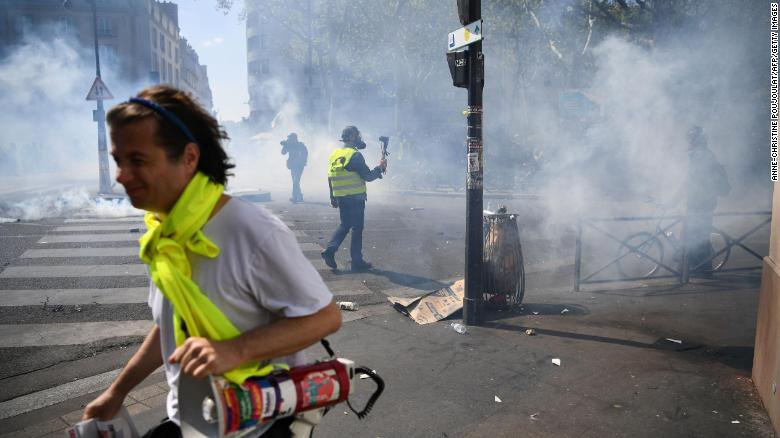Paris police use tear gas against yellow vest protesters