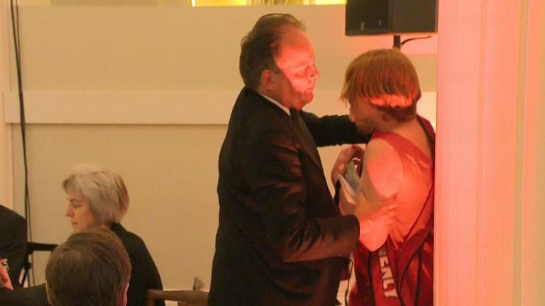 Mark Field suspended as minister after grabbing climate protester by neck
