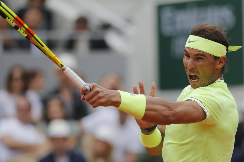 The Latest: Nadal beats Thiem for 12th French Open title