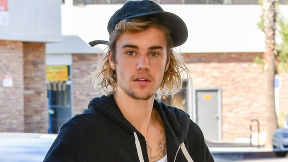 Justin Bieber Calls Out Tom Cruise and Wife Hailey Bieber During Bottle Cap Challenge