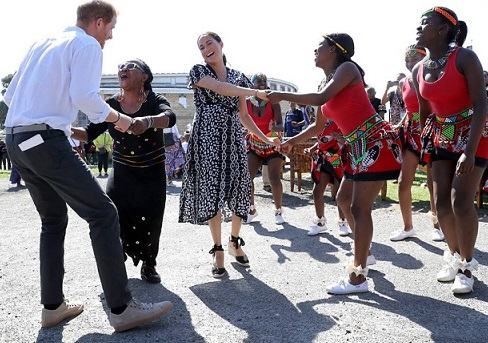 Meghan Markle and Prince Harry Kick Off Africa Tour With a Dance