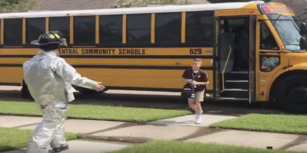 Creative teen surprises little brother at his bus stop wearing a new costume every day