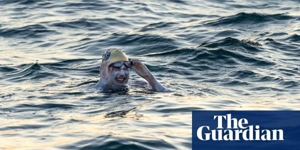 Woman becomes first person to swim Channel four times non-stop – video