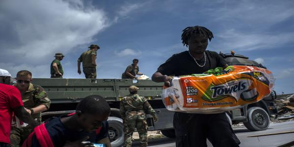 Survivors on Bahamas island mark time as officials lay plans