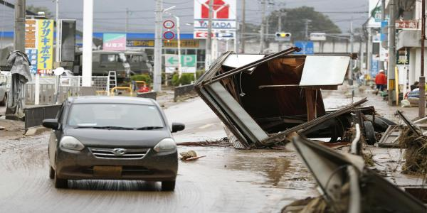 Japan looks for missing after typhoon, warns of mudslides