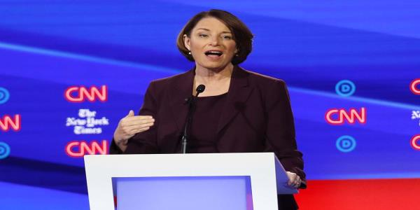Klobuchar charges at Warren