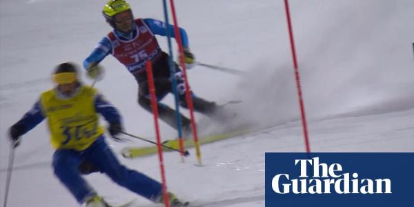 World Cup slalom skier interrupted by course worker on slopes – video