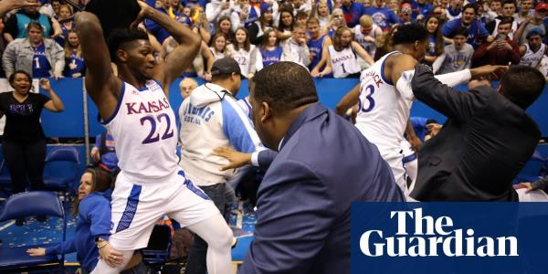 Brawl breaks out at the end of Kansas college basketball game – video report