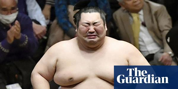 Japan in raptures as outsider wins sumo contest – and bursts into tears