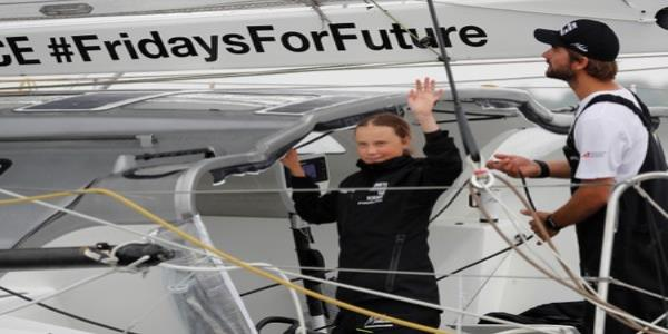 Swedish teen climate activist arrives in New York by boat for U.N. summit