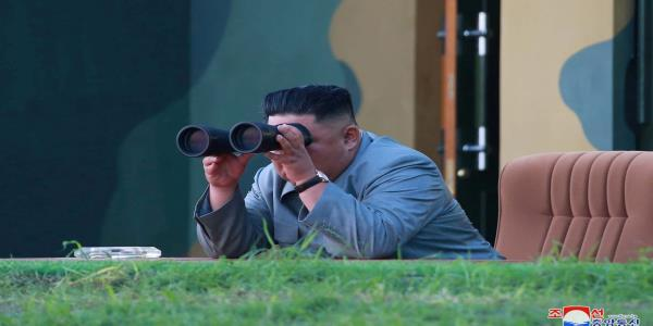 North Korea conducts new missile tests as Trump backs Kim on war games