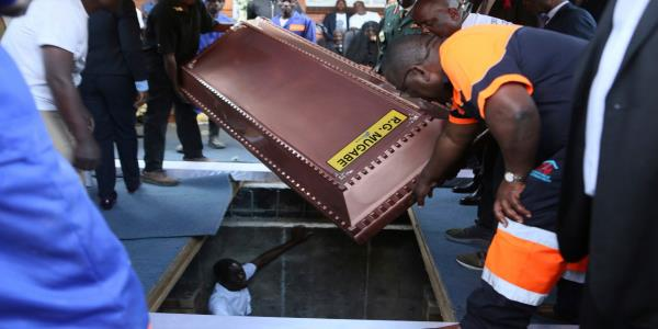 Robert Mugabe buried in a steel coffin encased in concrete as family claims people are after his body