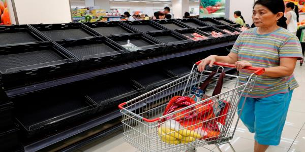 Empty supermarket shelves as Hong Kong shops close their doors amid protests