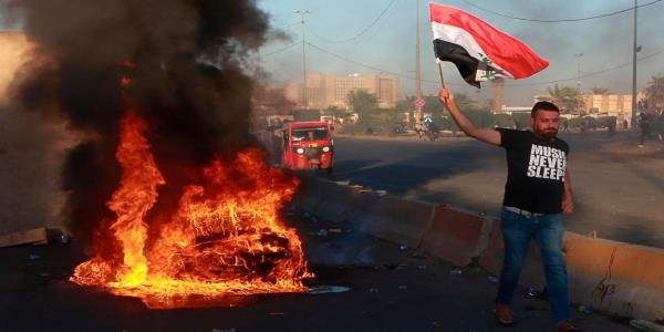 Iraq protests: Powerful cleric Moqtada al-Sadr demands government resign as toll rises close to 100