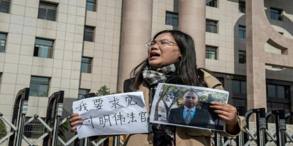 Chasing shadows in China: Detained lawyers wife battles on