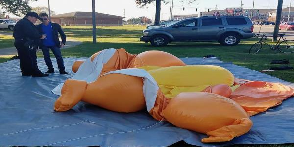 Baby Trump balloon slashed at Alabama appearance