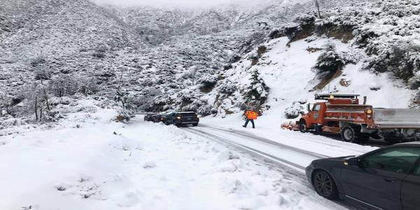 California snow-bound highway reopens but storm snarls Thanksgiving travel
