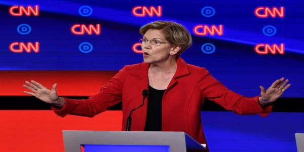 Elizabeth Warren cant contain her delight at the idea of John Delaney paying her wealth tax