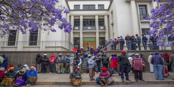 Pensioners Sleep Outside Zimbabwe Banks as Savings Vanish Again