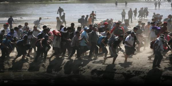 Migrants tear-gassed as they try to storm into Mexico