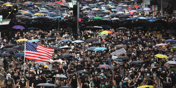 Hong Kong plunged into pandemonium as protesters spread throughout city in unsanctioned march