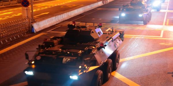 China says tanks crossing border into Hong Kong are routine troop rotation