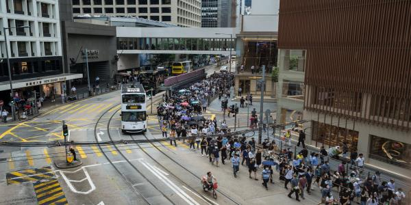 Man Held After Teenager Stabbed, March Goes On: Hong Kong Update