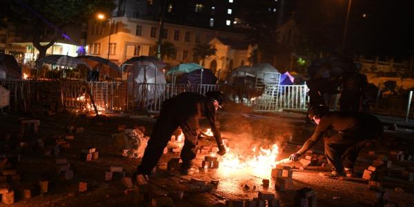 Hong Kong protesters unleash stash of petrol bombs; Chinese soldiers clear roads