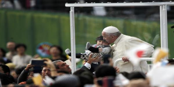 The Latest: Pope rides in carbon-free popemobile in Japan