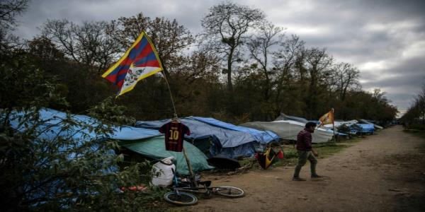 French police clear 600 Tibetan migrants from camp outside Paris