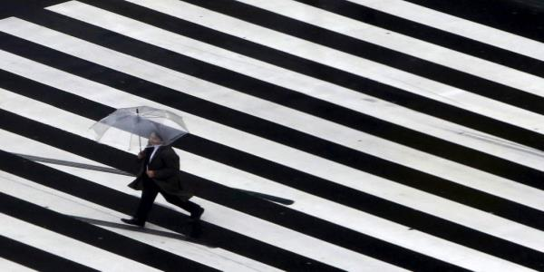 Japans economy shrinks faster than first estimated on growing virus, recession risks
