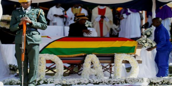Robert Mugabe buried in private ceremony after weeks of drama over former Zimbabwean leaders resting place