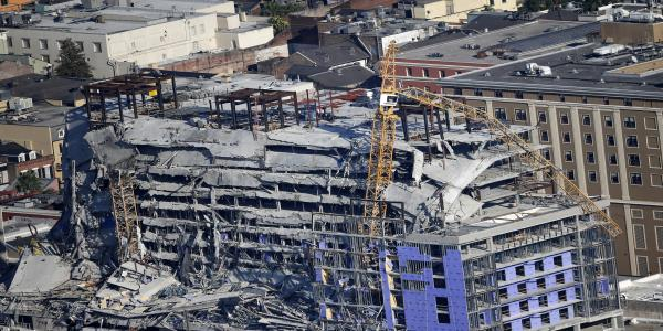 Leaning cranes toppled at partly collapsed New Orleans hotel