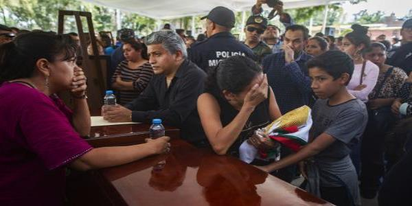 They were sent to the slaughter: Mexico mourns 13 police killed in cartel ambush