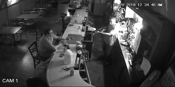 Watch a man brazenly light a cigarette at gunpoint during an armed robbery