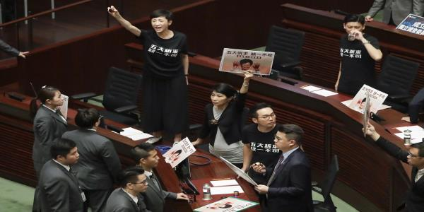 The Latest: HK protest organizer attacked with hammers