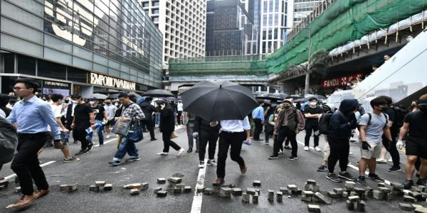 Chaos in Hong Kong as pro-democracy protests blossom everywhere