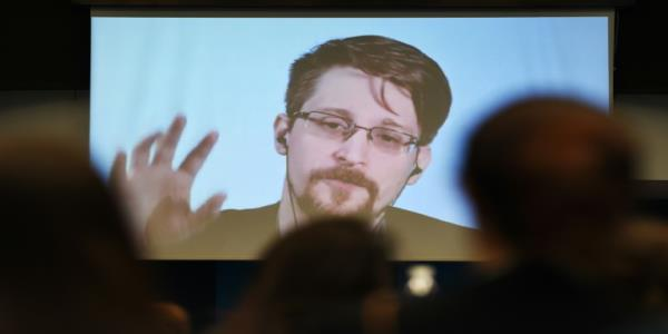 Snowden says he would return to US if he can get a fair trial