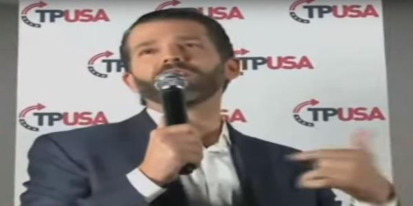Trump Jr booed off stage by supporters of his father amid apparent split in US far right