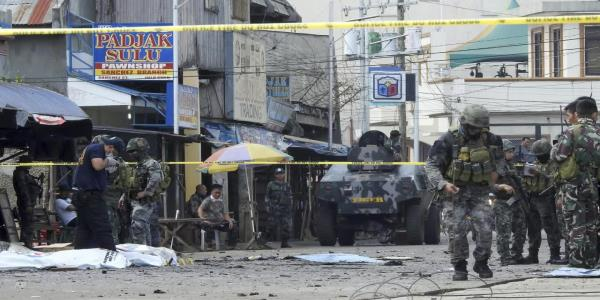 Briton, Filipino hostages safe after troops clash with Islamist rebels