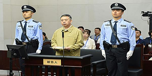 Chinas former Interpol chief sentenced to 13 years in prison
