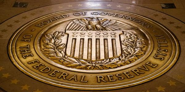 Fed ramps up lending, bond buying to calm financial markets